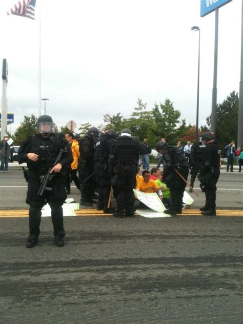cops armed in riot gear arrive at walmart overview for utsavman