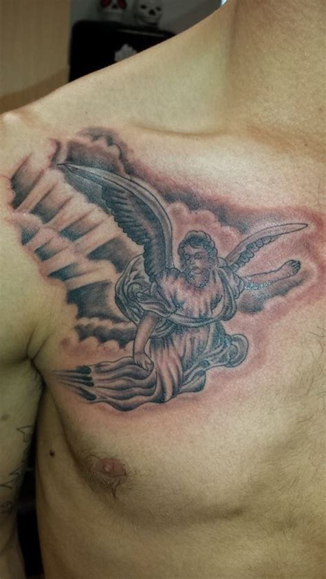 archangel angel godly religious chest collarbone tattoo