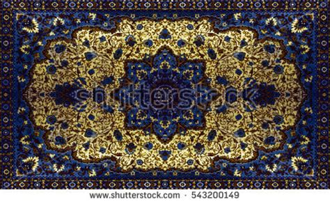 red blue brown white oriental flowers patterned roller persian carpet texture abstract ornament round stock photo