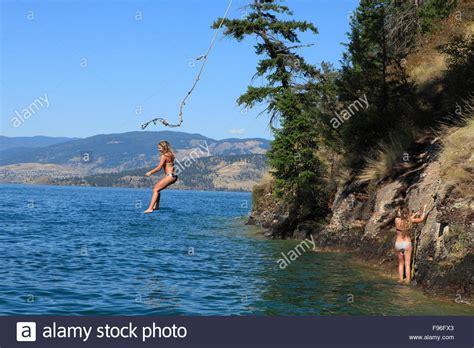 rope swing lake rope swing young female kalamalka lake vernon british