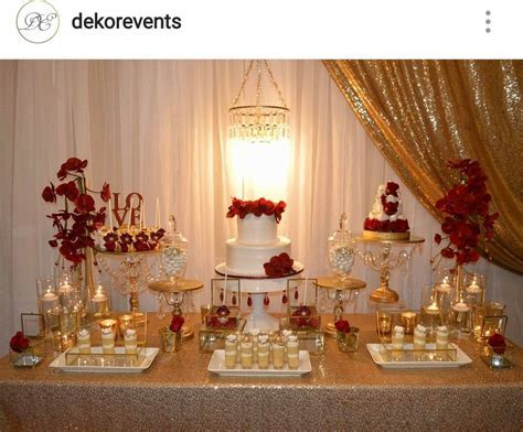 Gold, white, and Red Engagement Party Dessert Table and