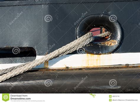 ropes tying a ship to the dock in port