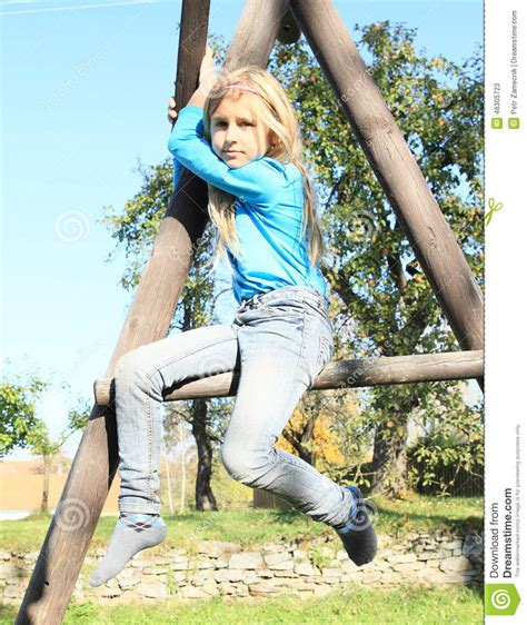 young little girls socks scared girl sitting on climbing frame stock image image
