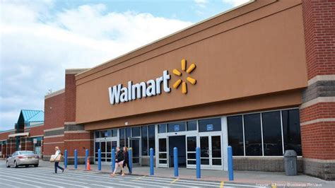 walmart hours of operation wal mart cuts hours as wages increase business