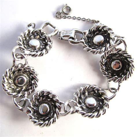 coro blue rhinestone bracelet with silver tone rope swirls