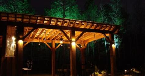 hanging lights on pergola sconces highlight the pergola s beams while the