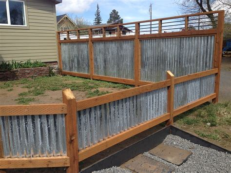 idea for wood metal mix decorations corrugated metal fence panels could help protect the pets
