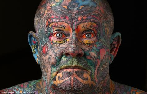 man covers every inch of his body in tattoos