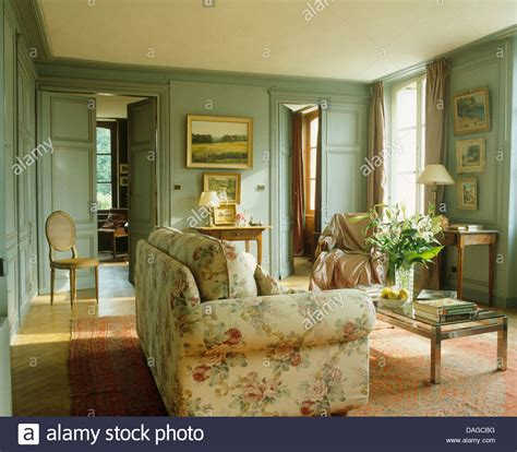 how do you say sofa in french traditional living room with french doors exposed beam in