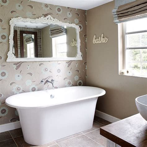 wallpapered bathrooms ideas bathroom with floral wallpaper and modern roll top bath