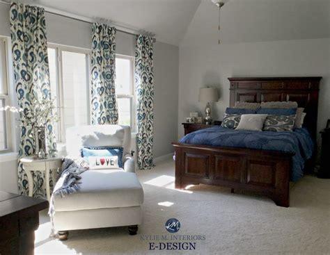 sherwin williams repose gray master bedroom with dark cherry wood furniture navy blue white