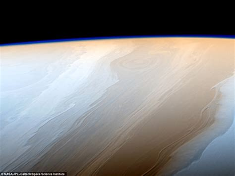 pictures on saturn cassini sends back poignant image of saturn s pole