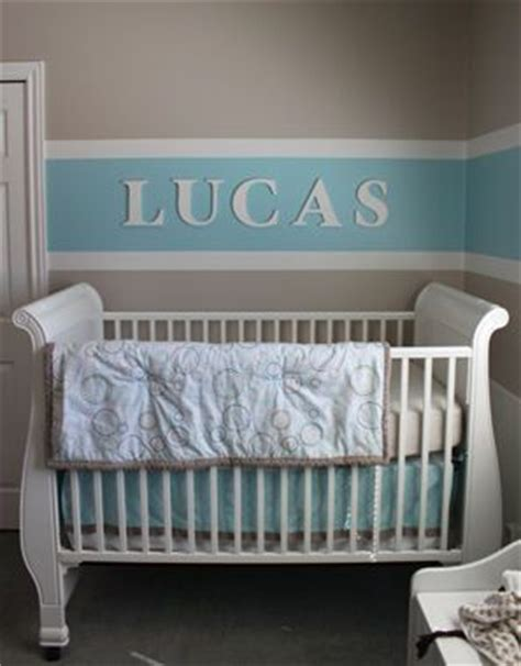baby boy nursery room decorated with baby blue brown and white horizontal wall paint