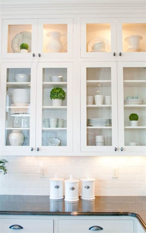 glass front kitchen cabinet door the pops of green in with the clean white