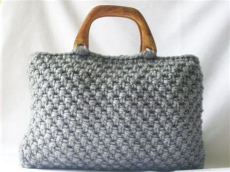 Make Jealous With A Handknit Knitting Bag Clutch Fashiontribes Fashion by 17 Best Images About Knit Crochet Handbag Inspiration On