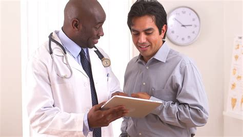 and in kolofata an american doctor in africa books american doctor using tablet pc with hispanic