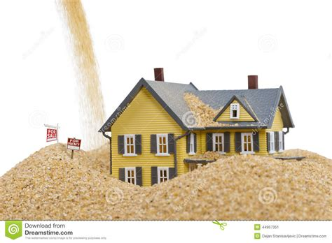 Sinking Real Estate house sinking in sand with for rent sign and word help written in sand stock photo image