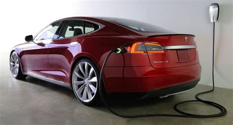 Charging Tesla At Home Elon Musk Tesla Working On Wall Charger That S Like A