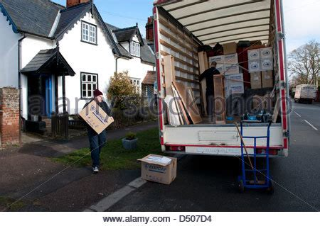 moving home. removal men move contents of photographers