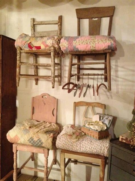 hang vintage chairs on the wall as quilt displays for