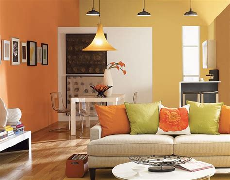 hgtv home by sherwin williams orange paint color sw 6649 energizes this living room