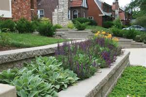 retaining wall and flower bed featuring decorative plants