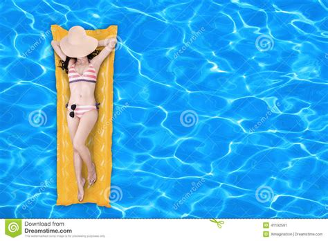 mattress in a pool floating on a pool mattress 1 stock photo image