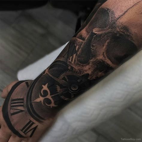 skull and clock tattoo on half sleeve tattoo designs
