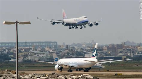 airlines cancel more than 200 flights tensions between china and taiwan