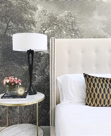 white tufted headboard with nailhead trim transitional a bedroom accent wall is clad in anthropologie etched