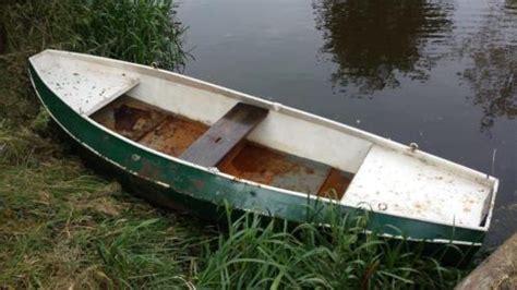 ijzeren roeiboot te koop stalen boot 4 meter en johnson 4 pk motor koopje 399