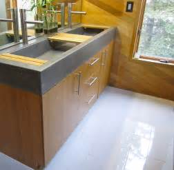 grey concrete sink and steel faucet brown