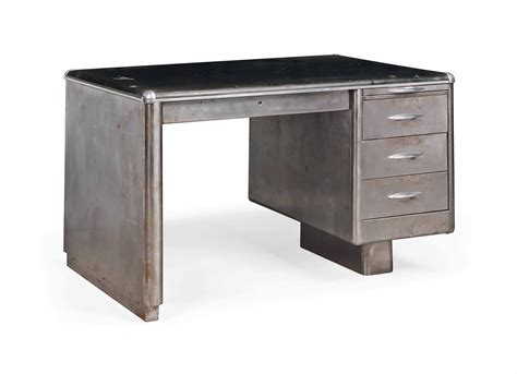 a metal desk with rubberized top possibly american