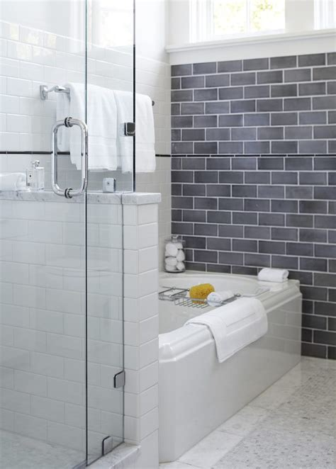 shower with gray subway tiles transitional bathroom dishy half bath decor with wood vanity modern fixtures
