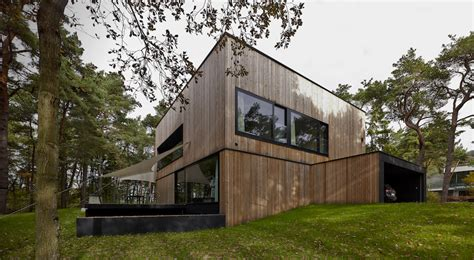 Wood Cladding House Seaside House With Concrete And Timber Cladding By Ultra
