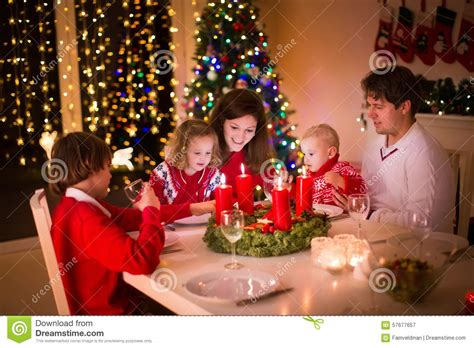 la navidad y los 8467727675 family with children at christmas dinner stock image image 57677657