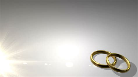wedding rings in light motion background videoblocks
