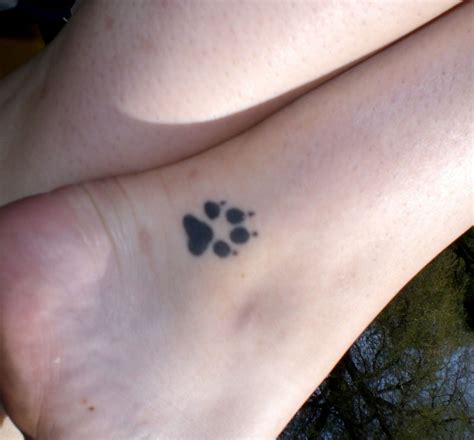 dog paw print tattoos for women