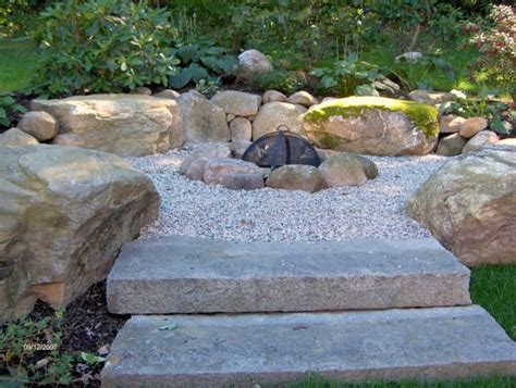 rock firepit pit with gravel pool