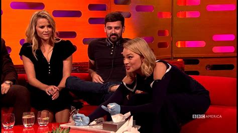 graham norton tattoo on neck margot robbie gives one of her biggest fans a toe tattoo