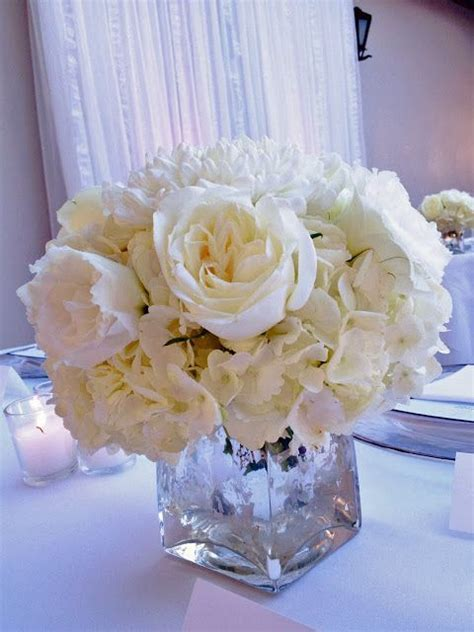 white rose and hydrangea centerpiece in silver mercury