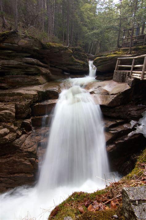 white waterfall  blue calmed body  water