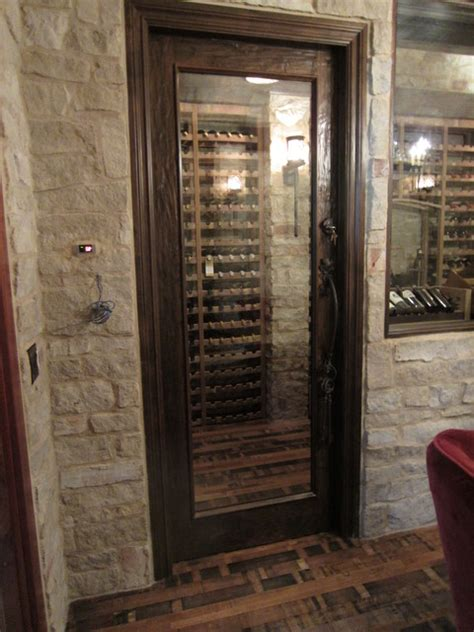 wine room doors barolo glass custom wine cellar door with heavy distressing traditional wine cellar other