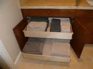 bathroom vanity with towel storage height pulloutshelves in a bathroomcabinet