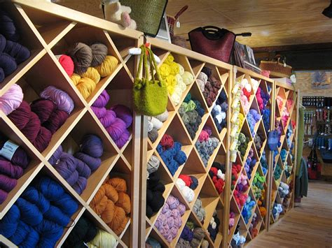 knitting store wi fluffy flowers pickles in the yarn store