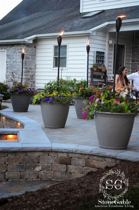 backyard tiki torches 25 best ideas about landscaping along fence on pinterest