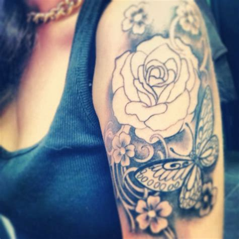 tattoo on arm girly half sleeve in process not finished yet roses butterfly s