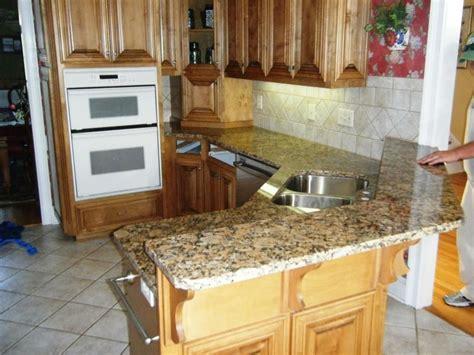 giallo fiorito granite with oak cabinets giallo fiorito granite on medium wood cabinets 3 8 08
