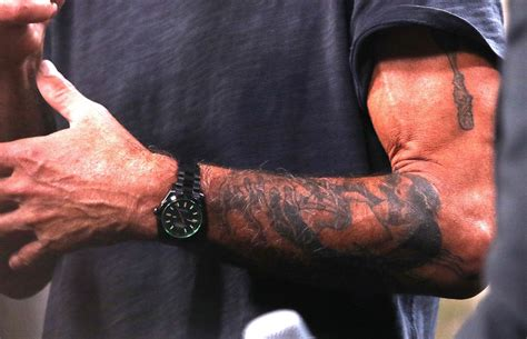 anthony bourdain s tattoos documented his culinary
