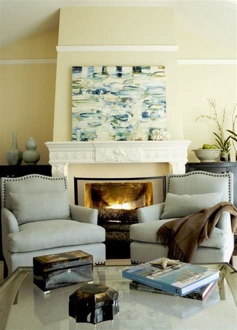 seating in front of fireplace yellow and blue living room transitional living room